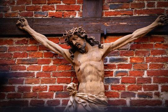 Crucifixion of Jesus Christ. Antique statue. Horizontal image.