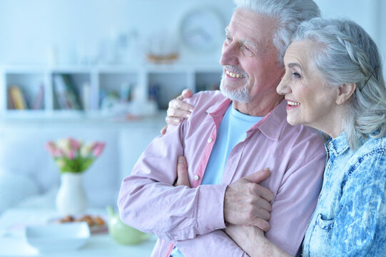 Close up portrait of happy senior couple posing
