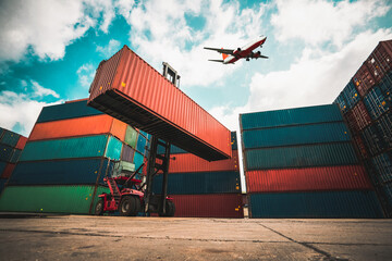 Fototapeta Cargo container for overseas shipping in shipyard with airplane in the sky . Logistics supply chain management and international goods export concept . obraz