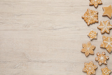 Tasty Christmas cookies on beige wooden table, flat lay. Space for text