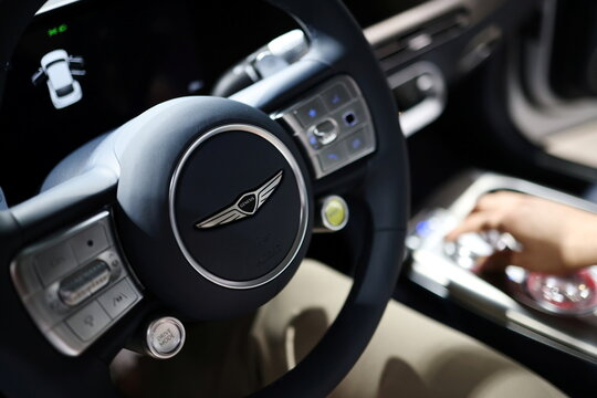 The logo of Genesis is seen on the steering wheel of its electric vehicle GV60, on display during its showcase in Seoul
