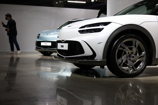 Genesis' GV60 electric vehicles are displayed during their showcase in Seoul
