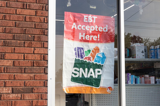 SNAP and EBT Accepted here sign. SNAP and Food Stamps provide nutrition benefits to supplement the budgets of disadvantaged families.