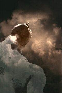 Statue Under Dramatic Clouds