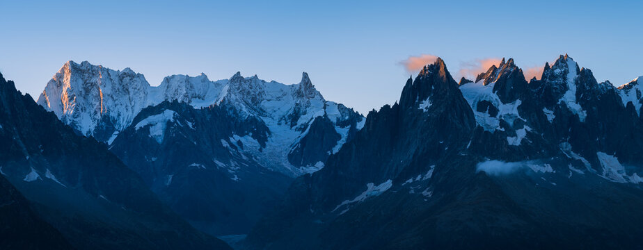 Panorama of the mountain peaks near Chamonix during a tranquil dawn.