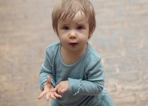 Cute little baby girl. Developing Fine Motor Skills