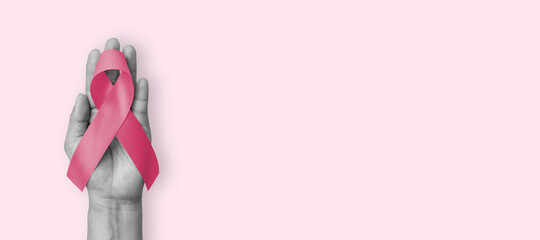 Obraz Pink ribbon for breast cancer awareness in October, wear pink day charity for woman health fighting with breast tumor illness (bow isolated with clipping path on white background) - fototapety do salonu