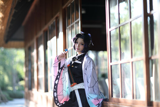 Japan anime cosplay portrait of girl with comic costume with japanese theme garden