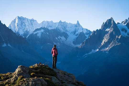 A woman looking at the mountains near Chamonix, France, on a beautiful morning.
