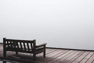 Fototapeta Depression and silence. Lonely bridge. Silence lake. Fog obraz