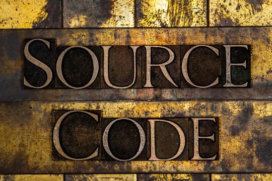 Source Code text on textured grunge copper and vintage gold background