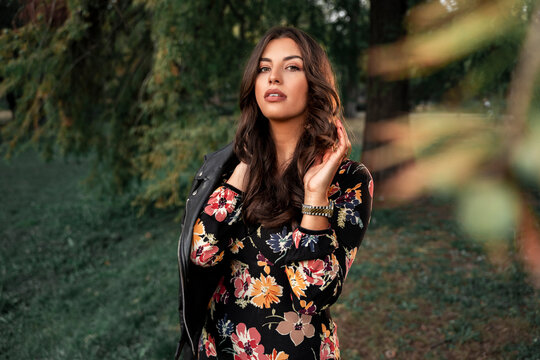 Fall fashiom and beauty portrait, attractive feminine brunette in dress and with leather jacket