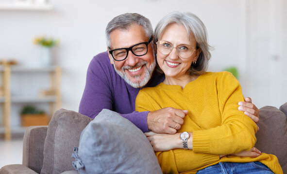 Portrait of happy beautiful senior caucasian family couple in love smiling at camera at home