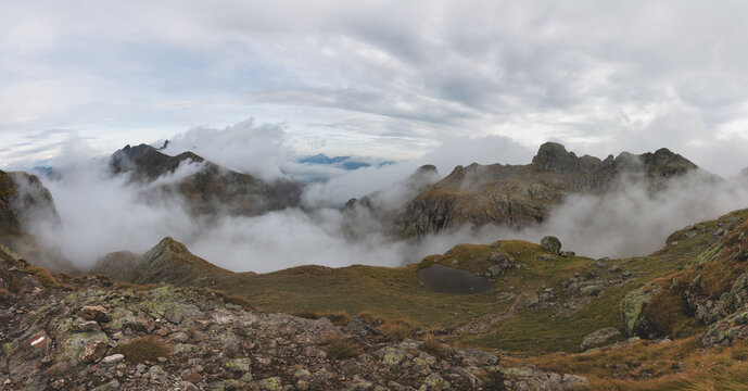 Alpine panorama with clouds in the valleys