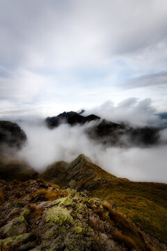 Mountain landscape with clouds around the peaks