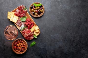 Fototapeta Antipasto board with prosciutto, salami, crackers, cheese, olives obraz