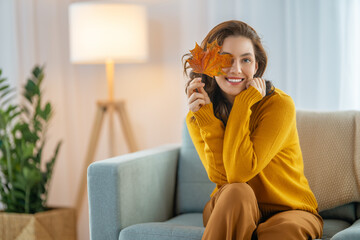 Fototapeta woman resting on sofa at home obraz