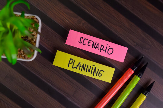 Scenario Planning write on sticky notes isolated on Wooden Table.