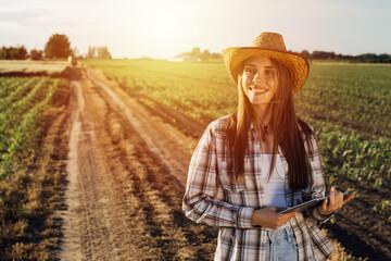 Obraz woman farmer walking outdoor - fototapety do salonu