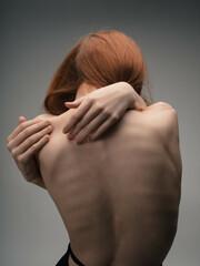 Fototapeta naked back women red hair posing studio obraz
