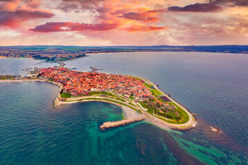Fototapeta Wonderful spring view from flying drone of old town of Nessebar. Picturesque seascape of Black sea. Aerial outdoor scene of Bulgaria, Europe. Traveling concept background. Beautiful summer scenery. obraz
