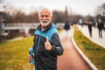 Obraz Happy senior man is ready for exercising in park. - fototapety do salonu