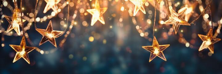 Obraz Gold star light hanging on dark background - fototapety do salonu