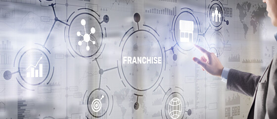 Businessman hand touching inscription Franchise marketing system