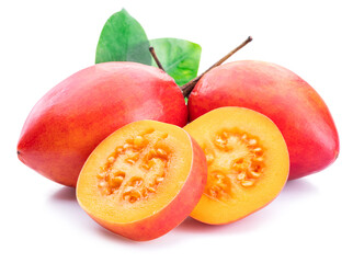 Ripe tamarillo fruits with slices and tamarillo leaves isolated on a white background.