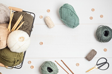 Fototapeta Craft hobby background with yarn in natural colors. Recomforting, destressing hobby for cold fall and winter weather. Mock up, copy space, top view obraz