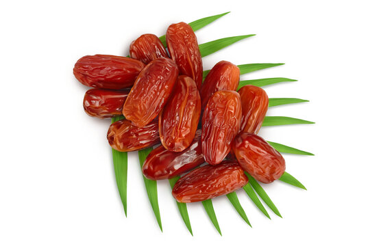 Dates isolated on white background with clipping path. Top view. Flat lay