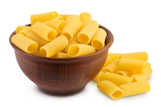 raw italian Rigatoni pasta in ceramic bowl isolated on white background with clipping path and full depth of field