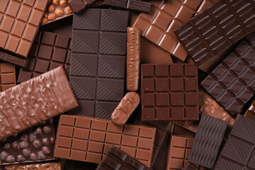 Fototapeta milk and dark chocolate bar, dessert food background. obraz