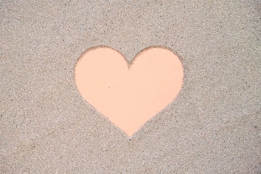 Background image of pink heart drawn on sand, Valentine day concept