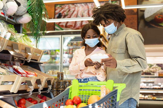 African American Couple Choosing Vegetables Doing Grocery Shopping Together Indoor