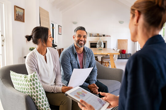 Couple talking to financial advisor at home