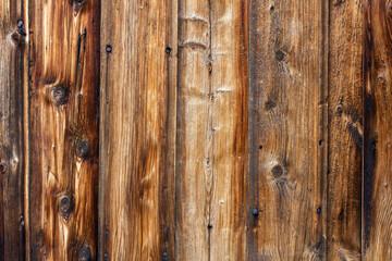 Fototapeta Drewniane tło z brązowych desek z widocznymi sękami obraz