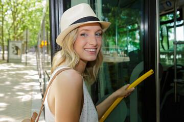 Fototapeta portrait of a woman going by bus obraz