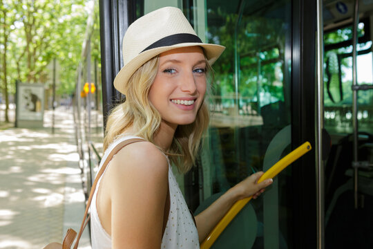 portrait of a woman going by bus