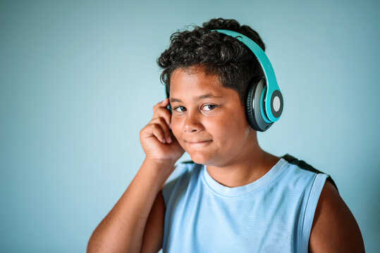 Ethnic boy listening to music in headphones