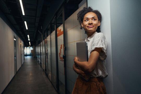 Smiling woman is having break after meeting