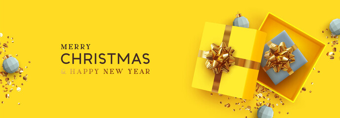 Obraz Yellow Christmas banner. Xmas Background realistic design open gifts box with surprise, bauble ball 3d render and glitter gold confetti. Horizontal new year poster, greeting card, headers website - fototapety do salonu