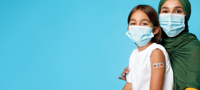Vaccinated Muslim Girl And Mother In Mask Posing, Blue Background