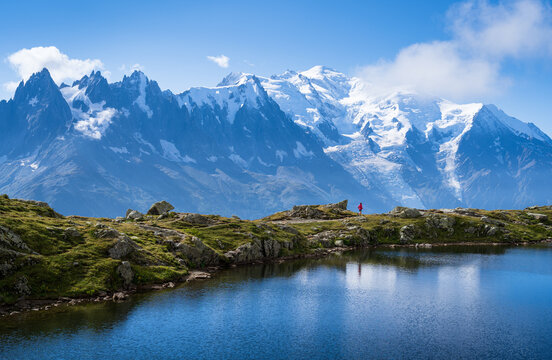 Athlete trail running at Lac De Cheserys, with the Mont Blanc in the background.