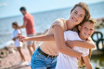 Obraz Happy weekend on a beach with a whole family - fototapety do salonu