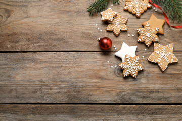 Fototapeta Tasty Christmas cookies and festive decor on wooden table, flat lay. Space for text obraz