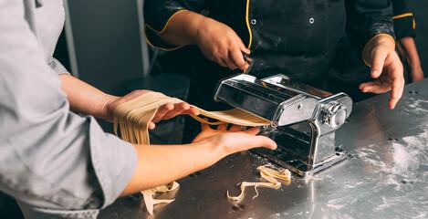 Fototapeta Close up photo pf pasta making process in a professional kitchen. obraz