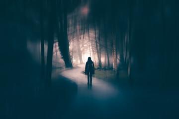 Obraz Horror halloween concept. strange silhouette in a dark spooky forest at night - fototapety do salonu
