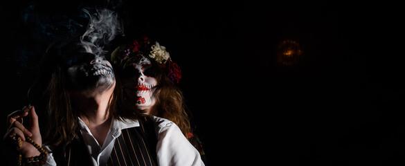 Obraz Woman in santa muerte costume and man in skeleton bodypainting for halloween. - fototapety do salonu