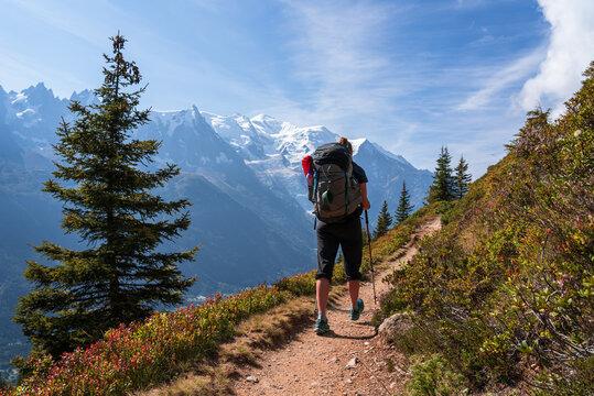 A woman hiking on the famous Tour du Mont Blanc near Chamonix, France.